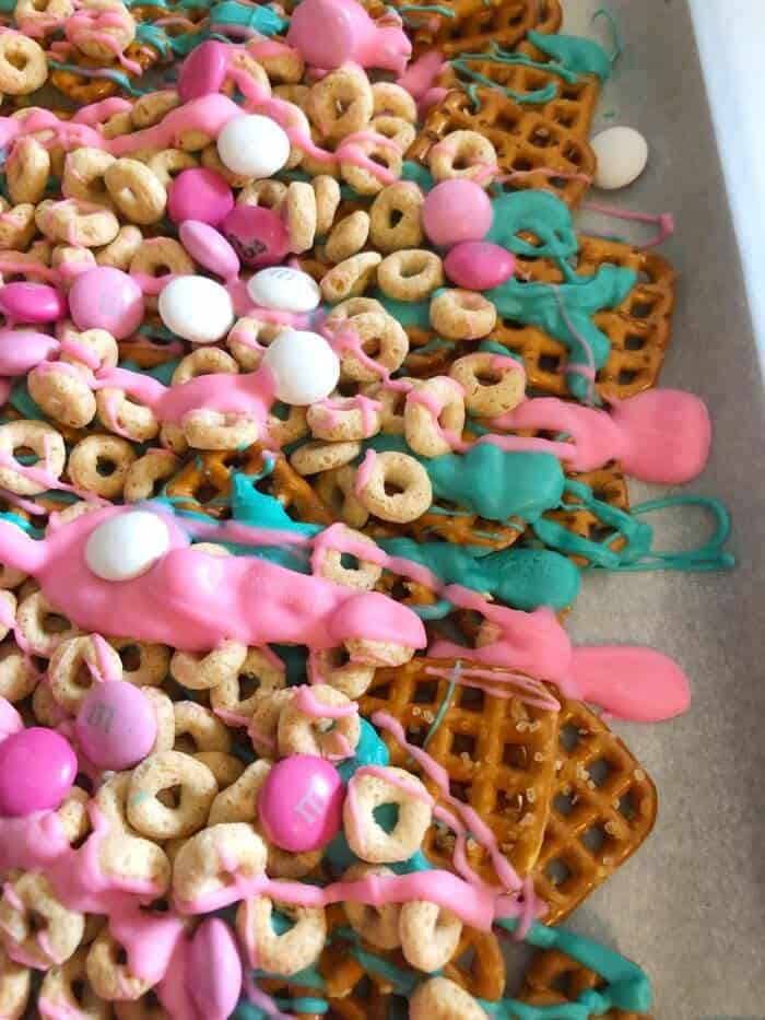 Trolls Party Snack Mix Up close full of pretzels, cheerios, and chocolate bites.