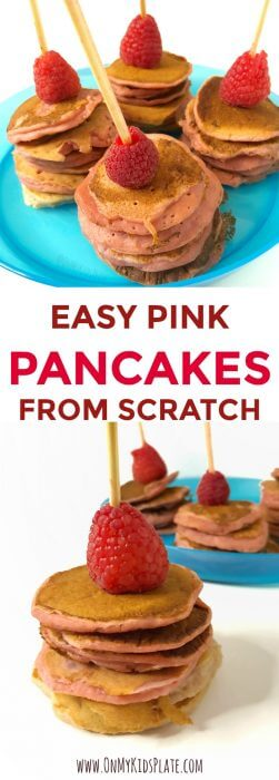 A the top of the image are four mini stacks of pink pancakes on kabobs, each one with a raspberry on top and sitting upon a blue kdi's plate. At the bottom of the image is a close up of a mini pink pancake stack on a kabob with a raspberry on top, and a plate ful of more pink pancake kabobs in the background. The title in the center reads easy pink pancakes from scratch.