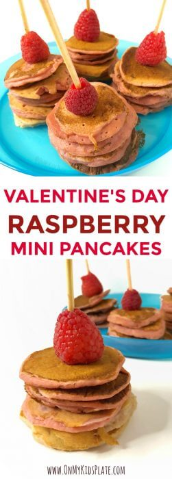 """A the top of the image are four mini stacks of pink pancakes on kabobs, each one with a raspberry on top and sitting upon a blue kdi's plate. At the bottom of the image is a close up of a mini pink pancake stack on a kabob with a raspberry on top, and a plate ful of more pink pancake kabobs in the background. The title in the center says """"Valentine's Day Raspberry Mini Pancakes."""""""