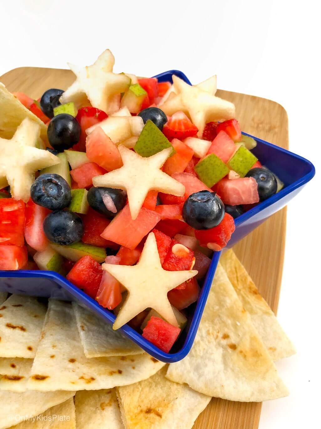 Sweet but healthy fruit salsa is a great red white and blue side to add to your bbq. Enjoy this yummy kid friendly salsa that is perfect to for a crowd or a potluck. #fruit #salsa #kidfriendly #partyfood #recipe #fourthofjuly