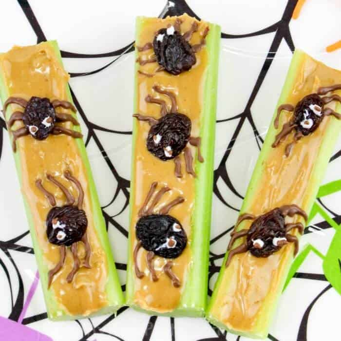 celery and peanut butter decorated with raisin spiders