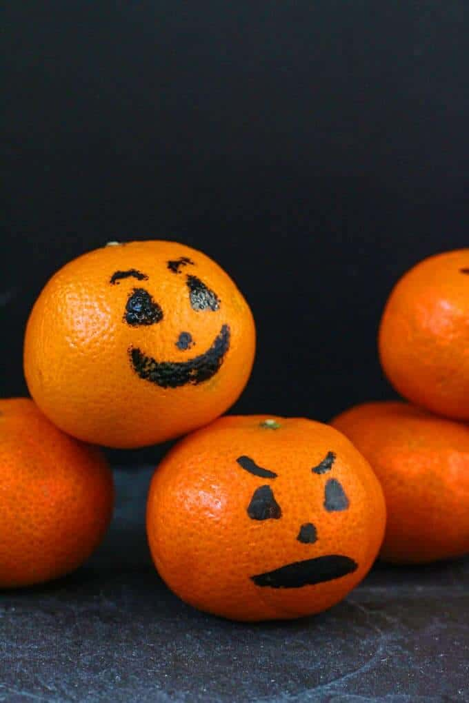clementines with jack o lantern faces