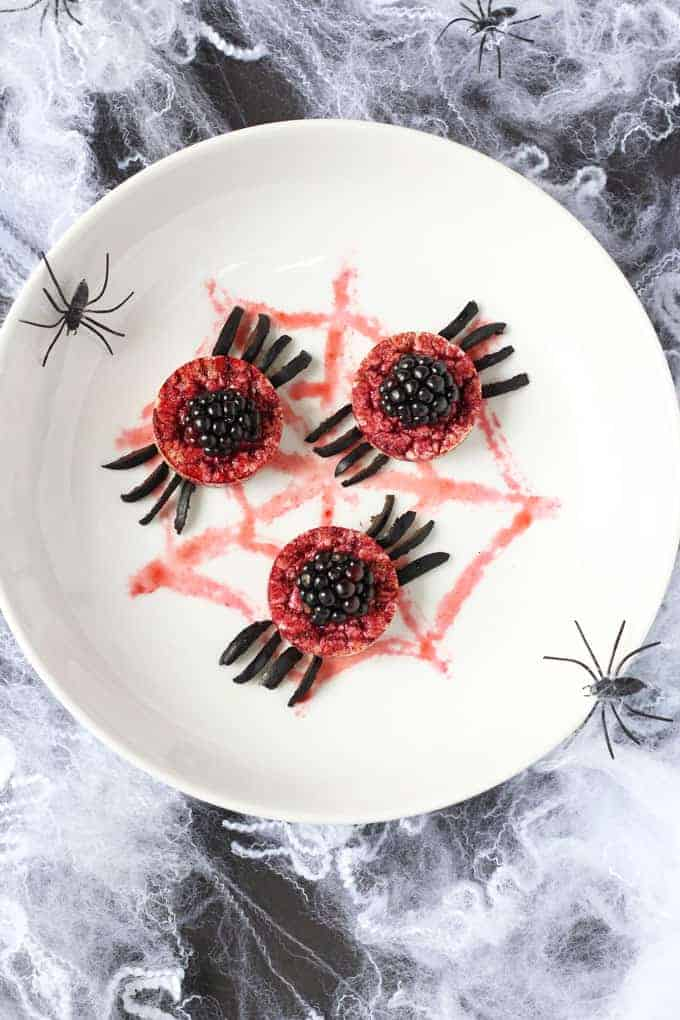 Rice cakes topped with fruit decorated like spiders