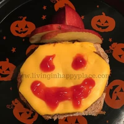 open sandwich with vampire face in ketchup