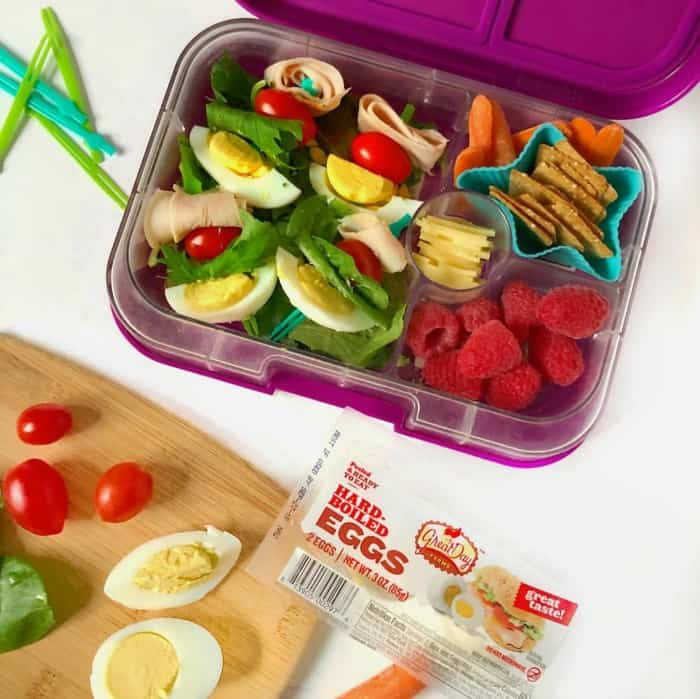 this healthy lunch idea for kids or adults includes a cobb salad on a kabob, fruit, cheese, carrots and pretzels.