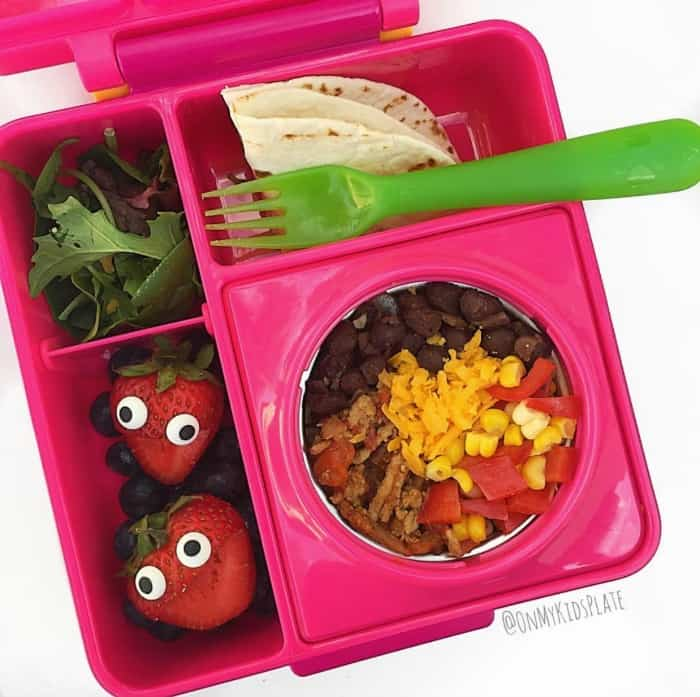 A lunchbox is full of a healthy lunch idea for kids, make your own taco filling! Also in the lunchbox is fruit, lettuce and a tortilla.
