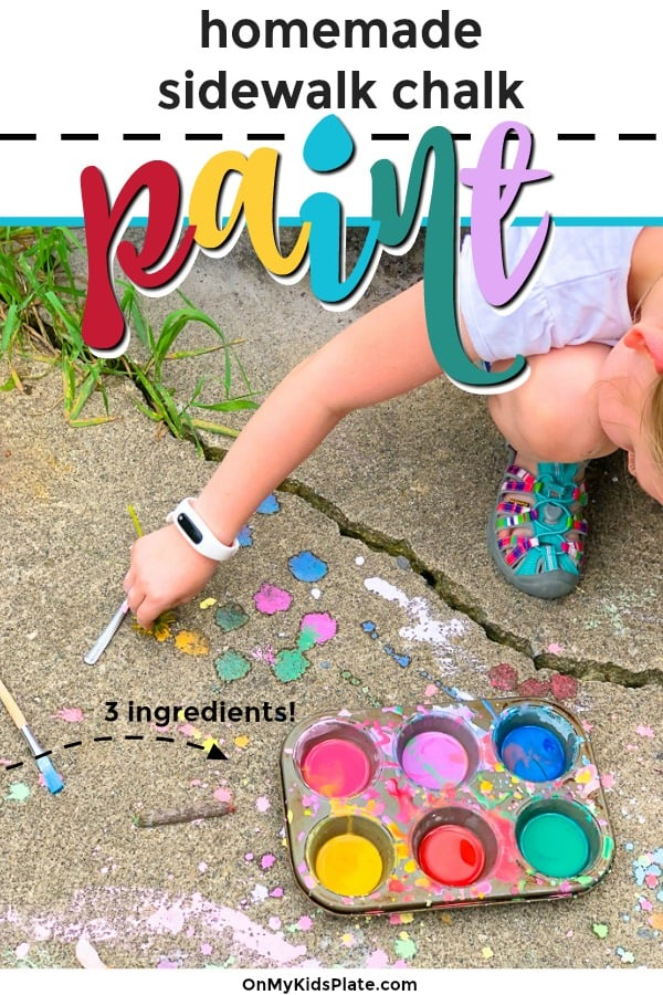 A child's arm and hand is seen painting on the sidewalk with a muffin tin full of colorful homemade sidewalk chalk paint and enjoying the summer sunshine.