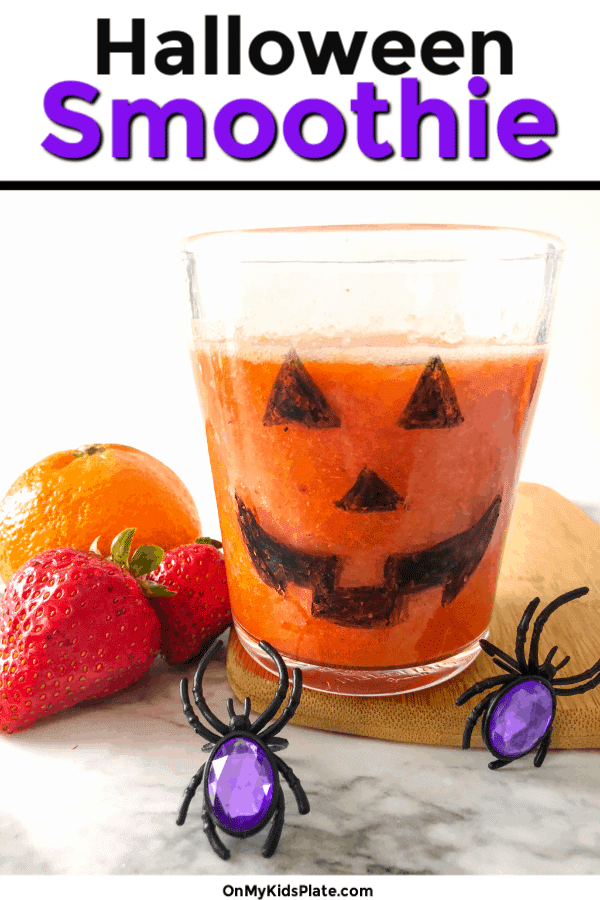 This healthy halloween breakfast smoothie starts breakfast or trick or treat off with a boost of strawberries and clementines that tastes like a creamsicle. Great for a spooky halloween snack, this jack o'lantern will make any kid or toddler grin! Great for a party too! #onmykidsplate #halloweenfood #healthyhalloween #smoothieforkids #halloweentreats #funfoodforkids #smoothies