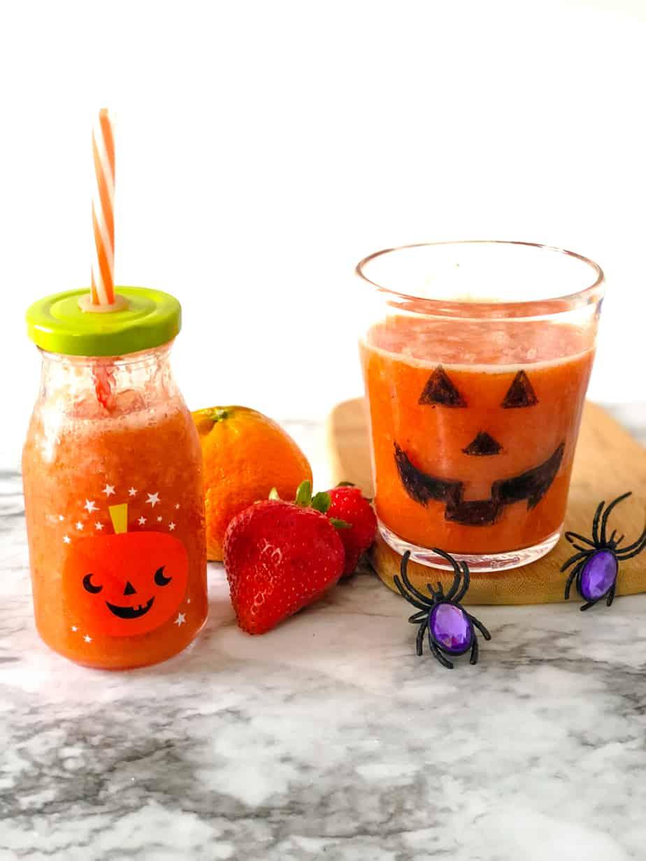 Orange smoothie in a pumpkin glass
