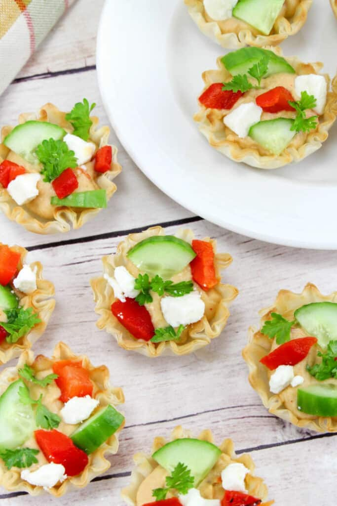 Mini phyllo cup appetizers filled with hummus, cucumber, feta and pepper