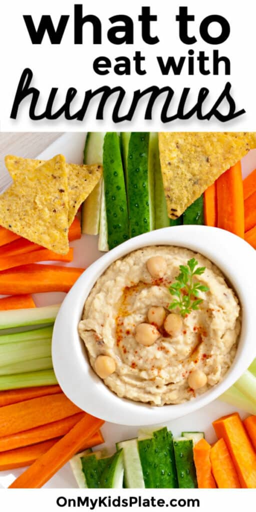 bowl of hummus with vegetables and tortilla chips and a text title overlay.