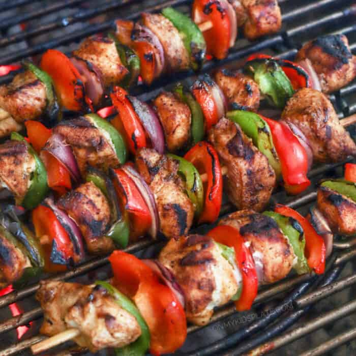 Chicken kabobs cooking on the grill