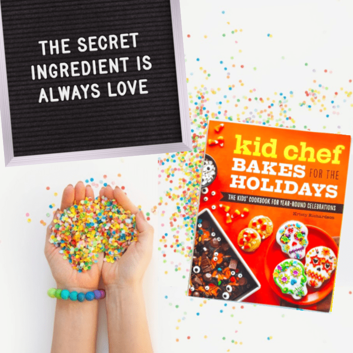 "Hands holding confetti next to the cookbook Kid Chef Bakes For The Holidays. Nearby a letterboard says ""The Secret Ingredient Is Always Love"""