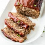 Sliced meatloaf from above on a platter
