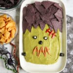 Close up of guacamole platter decorated like the monster Frankenstein