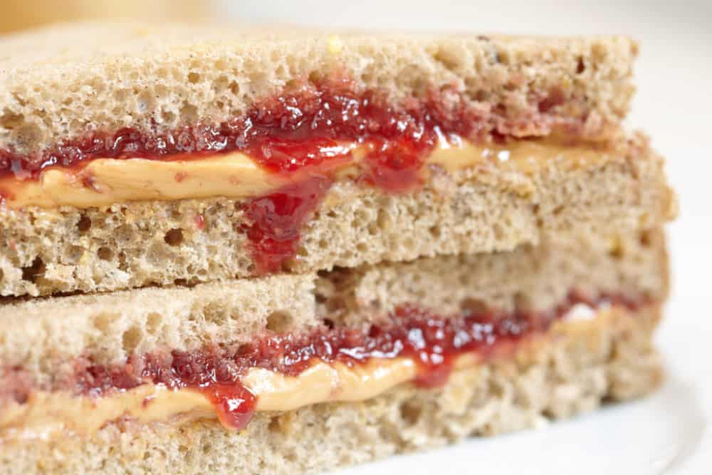 Up close stacked peanut butter with oozing jelly